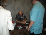 Keith Bettinger autographing a copy of MURDER IN MCHENRY