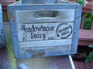 This is an old Meadowmoor Dairies Milk Crate. Meadowmoor Dairies was formed in 1931 by Al Capone.