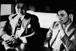 Al Capone Riding with Officer on Train Heading to Prison for Tax Evasion