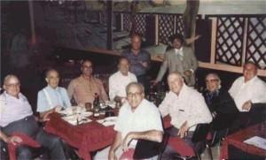 "L to R: Joey Aiuppa, Dom DiBella, Vince Solano, Al Pilotto; standing, L to R: Jackie Cerone and Joey Lombardo; front row, L to R: Tony Accardo, Joe Amato, Caesar DiVarco, and Jimmy ""Turk"" Torello"